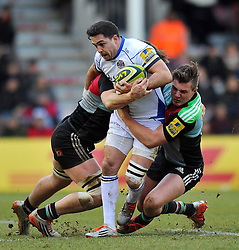 Horacio Agulla of Bath Rugby is double-tackled - Photo mandatory by-line: Patrick Khachfe/JMP - Mobile: 07966 386802 31/01/2015 - SPORT - RUGBY UNION - London - The Twickenham Stoop - Harlequins v Bath Rugby - LV= Cup