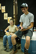 Youth from around the world converged on Oklahoma City for the American Quarter Horse Assocation (AQHA) Youth World horse show at the Oklahoma City Fairgrounds.  Each participant had to qualify either at the state or national level to compete.  All contestants under age 18 and horse must be owned by them or a direct family member...Amy Duncan and Robby Smith from Idaho hanging out waiting for their turn at the show.  Two day trip from Idaho, stopped in Utah once night and Kansas second night.
