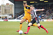 Grimsby Town midfielder Harry Clifton (15) and Port Vale defender Joe Davis (5) battles for possession  during the EFL Sky Bet League 2 match between Grimsby Town FC and Port Vale at Blundell Park, Grimsby, United Kingdom on 10 March 2018. Picture by Mick Atkins.