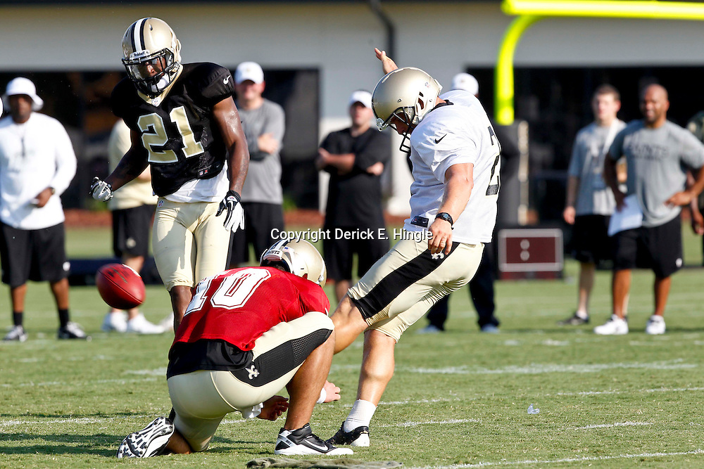 July 29, 2012; Metairie, LA, USA; New Orleans Saints place kicker John Kasay (2) kicks a field goal during a training camp practice at the team's practice facility. Mandatory Credit: Derick E. Hingle-US PRESSWIRE
