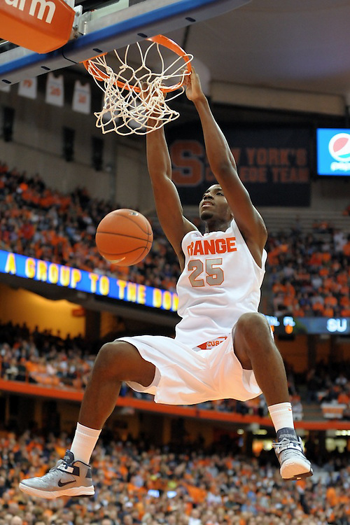 Syracuse Orange forward RAKEEM CHRISTMAS (25) finishes the dunk against the Monmouth Hawks during the second half at the Carrier Dome in Syracuse, New York. No. 4 Syracuse defeated Monmouth 108-56 in front of a crowd of 21,760.