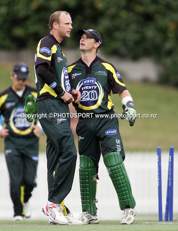 Ewan Thompson and Bevan Griggs celebrate after dismissing Tim Southee during the State Twenty20 cricket match between the Northern Knights and Central Stags at Seddon Park, Hamilton, on Saturday 13 January 2007. Photo: Renee McKay/PHOTOSPORT<br />
