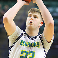 C.J. Gettys shoots a free throw against Liberty Wednesday December 17, 2014 at Trask Coliseum on the campus of UNCW in Wilmington, N.C. (Jason A. Frizzelle)