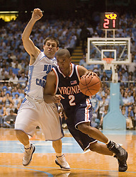 UVA's J.R. Reynolds (2) drives towards the basket against UNC's Wes Miller (22).  The #1 ranked Tar Heels beat the Cavaliers 79-69 to improved to 15-1 overall, 2-0 ACC on January 10, 2007 at the Dean Smith Center in Chapel Hill, NC...<br />