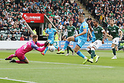 Alex Palmer saves under pressure from Luke Varney during the EFL Sky Bet League 2 match between Plymouth Argyle and Cheltenham Town at Home Park, Plymouth, England on 21 September 2019.