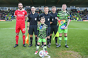 Mascot and captains during the EFL Sky Bet League 2 match between Forest Green Rovers and Scunthorpe United at the New Lawn, Forest Green, United Kingdom on 7 December 2019.
