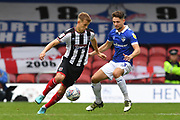 Grimsby Town midfielder Jake Hessenthaler(7) and Oldham Athletic defender Rob Hunt (23) during the EFL Sky Bet League 2 match between Grimsby Town FC and Oldham Athletic at Blundell Park, Grimsby, United Kingdom on 15 September 2018.