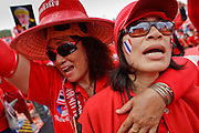 "Mar. 26, 2009 -- BANGKOK, THAILAND: Women at an anti-government protest in Bangkok, Thailand. More than 30,000 members of the United Front of Democracy Against Dictatorship (UDD), also known as the ""Red Shirts""  and their supporters descended on central Bangkok Thursday to protest against and demand the resignation of current Thai Prime Minister Abhisit Vejjajiva and his government. Abhisit was not at Government House Thursday. The protest is a continuation of protests the Red Shirts have been holding across Thailand in March.  Photo by Jack Kurtz"