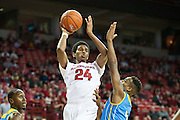 FAYETTEVILLE, AR - NOVEMBER 13:  Jimmy Whitt #24 of the Arkansas Razorbacks passes the ball while being guarded by Treiun Banks #3 of the Southern University Jaguars at Bud Walton Arena on November 13, 2015 in Fayetteville, Arkansas.  The Razorbacks defeated the Jaguars 86-68.  (Photo by Wesley Hitt/Getty Images) *** Local Caption *** Jimmy Whitt; Treiun Banks