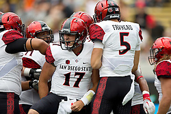 BERKELEY, CA - SEPTEMBER 12:  Quarterback Maxwell Smith #17 of the San Diego State Aztecs celebrates with teammates after scoring a touchdown against the California Golden Bears during the first quarter at California Memorial Stadium on September 12, 2015 in Berkeley, California. (Photo by Jason O. Watson/Getty Images) *** Local Caption *** Maxwell Smith