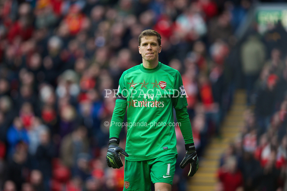 LIVERPOOL, ENGLAND - Saturday, February 8, 2014: Arsenal's goalkeeper Wojciech Szczesny looks dejected after his side are thrashed 5-1 by Liverpool during the Premiership match at Anfield. (Pic by David Rawcliffe/Propaganda)