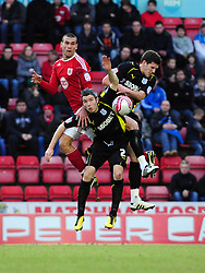 Bristol City's Steven Caulker Battles for the ball with Cardiff City's Kevin McNaughton and Cardiff City's Mark Hudson - Photo mandatory by-line: Joe Meredith/JMP - 01/01/2011 - SPORT - FOOTBALL - Championship - Bristol City v Cardiff City - Ashton Gate Stadium, Bristol, England