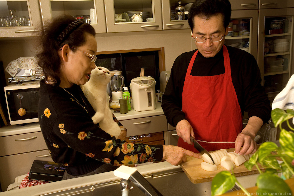 Hayashi Yoshitake (65) - reformed husband -  trying to learn cooking, while his wife Takeko Yoshitake (65) is teaching him.  They are both middle school teachers, she teaches music. They have been married for 39 years.  Tokyo 9 Feb. 2007