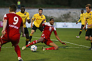 Whitehawk striker Danny Mills is tackled by Ebbsfleet Anthony Acheampong during the National League South Play Off 1st Leg match between Whitehawk FC and Ebbsfleet United at the Enclosed Ground, Whitehawk, United Kingdom on 4 May 2016. Photo by Phil Duncan.