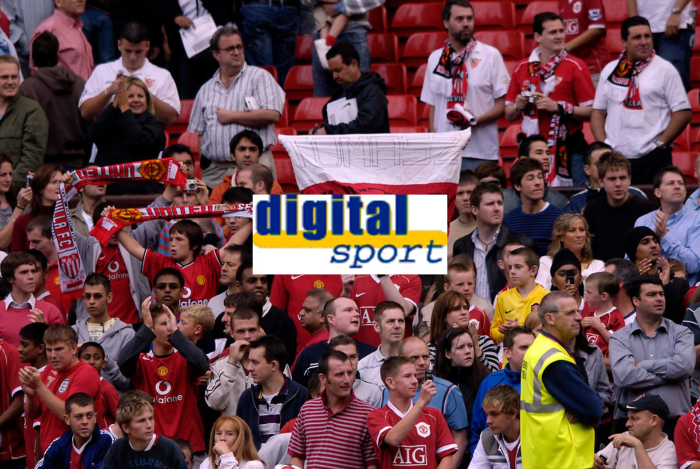 Photo: Jed Wee.<br />Manchester United v Seville. Pre Season Friendly. 12/08/2006.<br /><br />A fan holds aloft a Polish flag with Tomasz Kuszczak's name written across it.