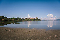 ANGUILLARA SABAZIA (LAKE BRACCIANO), ITALY - 26 JULY 2017: A view of a newly exposed earth in front of the town of Anguillara Sabazia on Lake Bracciano, whose level has dropped more than 1,50 meters recently, in Anguillara Sabazia (Lake Bracciano), Italy, on July 26th 2017.<br /> <br /> Lake Bracciano provides eight percent of Rome's water and has sunk about 1.5 meters<br /> <br /> A severe drought and sweltering temperatures have led Rome city officials to consider a potential rationing of drinking water for eight hours a day for a million and a half Rome residents. The water crisis has become yet another sign of man being at the mercy of an increasingly extreme climate, but also of once mighty Rome's political impotence, managerial ineptitude and overall decline.Lake Bracciano provides eight percent of Rome's water and has sunk about 1.5 meters<br /> <br /> A severe drought and sweltering temperatures have led Rome city officials to consider a potential rationing of drinking water for eight hours a day for a million and a half Rome residents. The water crisis has become yet another sign of man being at the mercy of an increasingly extreme climate, but also of once mighty Rome's political impotence, managerial ineptitude and overall decline.