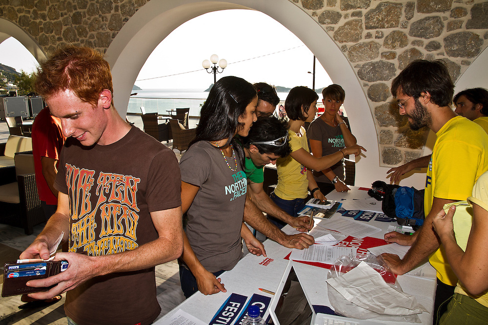 Greece, Dodecanese islands, Kalymnos island, the North Face Kalymnos Climbing Festival 2012 - At the hotel where the base camp of the event was set during the athletes registration. From left to right, Gabrielle Moroni from Italy, Daila Ojeda and Dani Andrada from Spain, registering for the competition of the professional athletes. The North Face company and the Municipality of Kalymnos island, organize a series of Climbing Festivals for the next 3 years. An event that brings climbers from all around the world to the island to enjoy the climbing experience on more than 2500 pitches in the crags of Kalymnos. The North Face organized two days of the Open and Big Climbing Marathon in a region of different crags with more than 450 routes to climb with grades from 3c to 8a and 3 days of the project competition on a crag bolted by the crew of the company only for the best professional climbers worldwide.