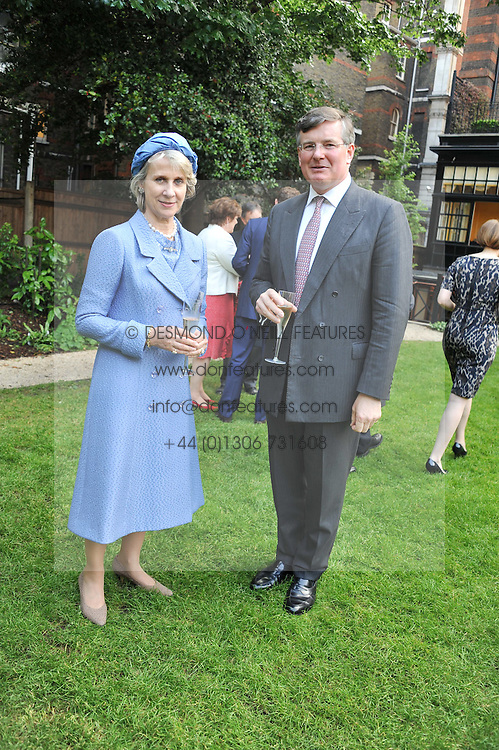 HRH The DUCHESS OF GLOUCESTER and CAPT.ASHE WINDHAM Chairman of the Friends of The Castle of Mey. at a reception hosted by the Friends of the Castle of Mey held at the Goring Hotel, Beeston Place, London on 22nd May 2012.