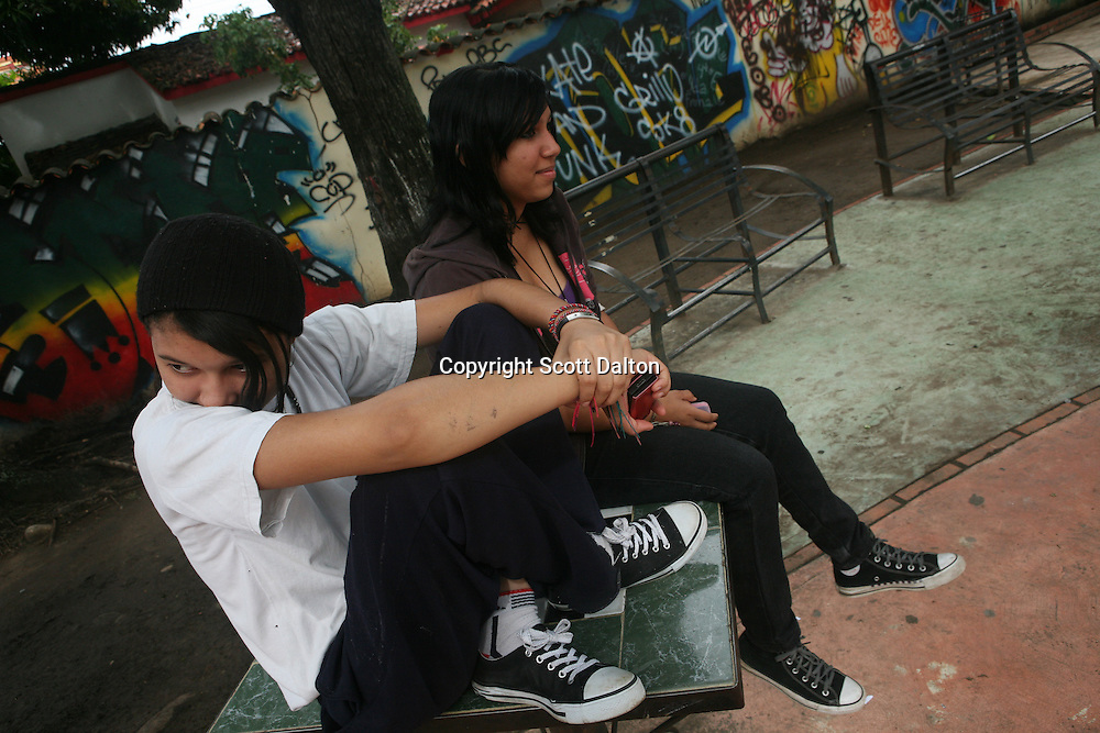 Two teenage girls hangout in a graffiti filled park in downtown Barinas, Venezuela on Friday, July 10, 2009. (Photo/Scott Dalton)