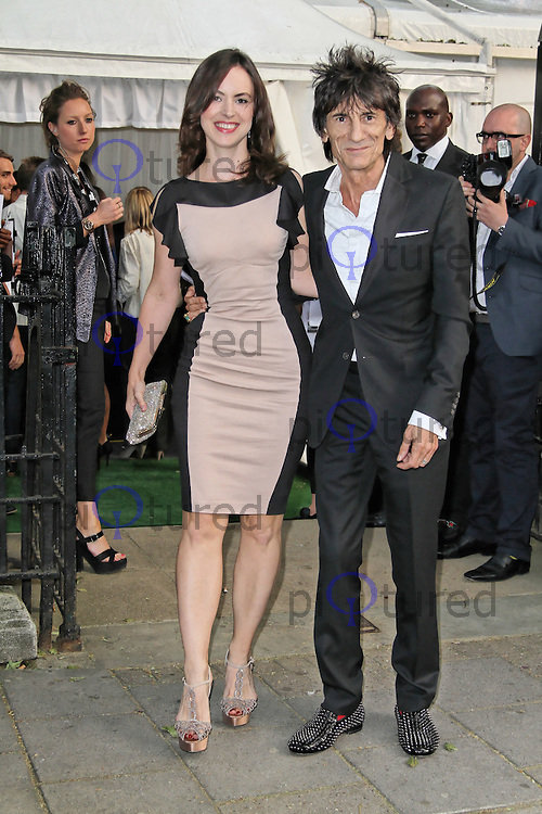 LONDON - MAY 29: Ronnie Wood; Sally Humphries attend the Glamour Women Of The Year Awards, Berkeley Square, London, UK. May 29, 2012. (Photo by Richard Goldschmidt)