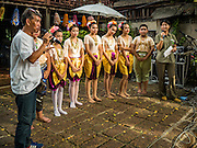 10 SEPTEMBER 2016 - BANGKOK, THAILAND: LEK, a community leader in Pom Mahakan, talks to a group of children who performed during a community party in the old fort. Forty-four families still live in the Pom Mahakan Fort community. The city of Bangkok has given them provisional permission to stay, but city officials say the permission could be rescinded and the city go ahead with the evictions. The residents of the historic fort have barricaded most of the gates into the fort and are joined every day by community activists from around Bangkok who support their efforts to stay.                PHOTO BY JACK KURTZ