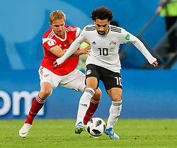 June 19, 2018 - Saint Petersburg, Russia - Yury Gazinsky (L) of Russia national team and Mohamed Salah of Egypt national team vie for the ball during the 2018 FIFA World Cup Russia group A match between Russia and Egypt on June 19, 2018 at Saint Petersburg Stadium in Saint Petersburg, Russia. (Credit Image: © Mike Kireev/NurPhoto via ZUMA Press)