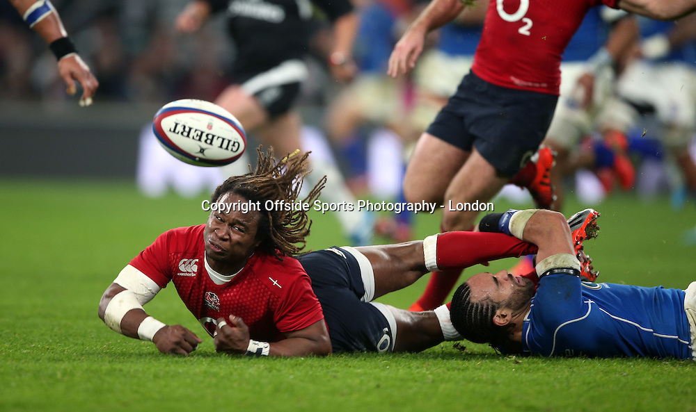 22 November 2014 International Rugby Union - England v Samoa;   The hair of England wing Marland Yarde flies as he drops the ball in the tackle.<br /> Photo: Mark Leech