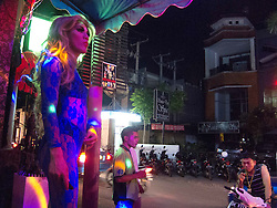 Drag queen outside the club in Bali/Seminyak looking at the street