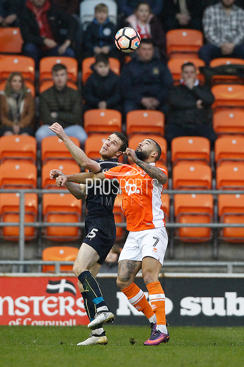 Barnsley's Marley Watkins (15) and Blackpool's Adam Hammill (7) during the The FA Cup 3rd round match between Blackpool and Barnsley at Bloomfield Road, Blackpool, England on 7 January 2017. Photo by Craig Galloway.