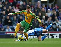 Photo. Andrew Unwin, Digitalsport<br /> Blackburn Rovers v Norwich, Barclays Premiership, Ewood Park, Blackburn 12/02/2005.<br /> Norwich's Dean Ashton (L) leaves Blackburn's Tugay (R) on the floor.