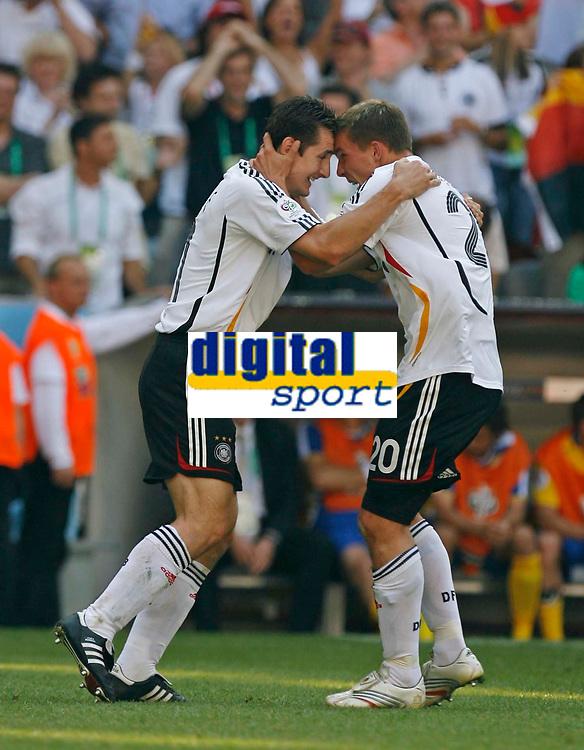 Photo: Glyn Thomas.<br />Germany v Sweden. Second Round, FIFA World Cup 2006. 24/06/2006.<br /> Miroslav Klose (L) and Lukas Podolski celebrate Germany's second goal, scored by Podolski.