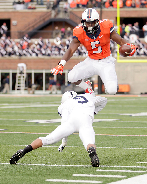 Illinois running back Donovonn Young (5) jumps over the tackle of Penn State cornerback Jordan Lucas (9) during the second half of an NCAA college football game at Memorial Stadium Saturday, Nov. 22, 2014, on the University of Illinois campus in Champaign, Ill. Illinois won the game 16-14. (Lee News Service/ Stephen Haas)