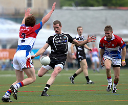 May 6, 2012; Bronx, NY; USA;  Sligo's Tony Taylor (8) kicks the ball while being defended by New York's Paul Lambe (2) during their game at Gaelic Park, Bronx, NY.