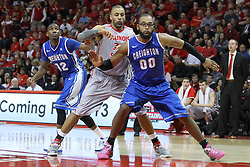 02 January 2013:  Jahenns Manigat, Jackie Carmichael and Gregory Echenique all respond during a free-throw during an NCAA Missouri Vally Conference (MVC) mens basketball game between the Creighton University Bluejays and the Illinois State Redbirds in Redbird Arena, Normal IL