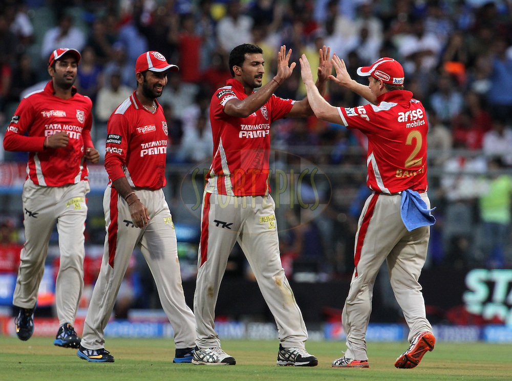 Rishi Dhawan of the Kings X1 Punjab celebrates with his teammates after taking the wicket of CM Gautam of the Mumbai Indians during match 22 of the Pepsi Indian Premier League Season 2014 between the Mumbai Indians and the Kings XI Punjab held at the Wankhede Cricket Stadium, Mumbai, India on the 3rd May  2014<br /> <br /> Photo by Vipin Pawar / IPL / SPORTZPICS<br /> <br /> <br /> <br /> Image use subject to terms and conditions which can be found here:  http://sportzpics.photoshelter.com/gallery/Pepsi-IPL-Image-terms-and-conditions/G00004VW1IVJ.gB0/C0000TScjhBM6ikg