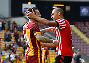 Romain Vincelot of Bradford City and Sunderland's James Vaughan embrace at full time during the Pre-Season Friendly match between Bradford City and Sunderland at the Coral Windows Stadium, Bradford, England on 22 July 2017. Photo by Paul Thompson.