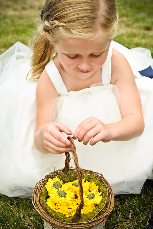 A flower girl awaits the ceremony at the Dexter Inn, Sunapee, NH.