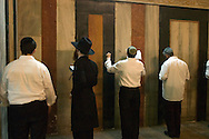 Jewish worshipers pray inside the grand hall of the Tomb of the Patriarchs (Ma'arat HaMachpela), normally inaccessible to Jews, except for ten days in the year, at the end of the Haye Sarah Shabbat. Thousands of Jews, and a large number of settlers, come to Hebron for the Haye Sarah during which the story of Abraham purchasing the land and cave on which stands the Tomb of the Patriarchs is read. Some six hundred Jews live in the heart of Hebron's old city surrounded by over 160,000 Palestinian inhabitants..Hebron, Israel. 03/11/2007.Photo © J.B. Russell/Blue Press