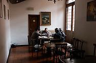 L'Aquila, Italia - 30 marzo 2013. Anziani a tavola in uno dei pochissimi bar aperti al centro della città dell'Aquila..Ph. Roberto Salomone