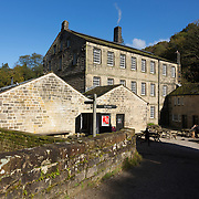 Gibson Mill, a water powered 19th century cotton mill at Hardcastle Crags, near Hebden Bridge, in Autumn. The mill is owned by the National Trust and was opened as a visitor centre in 2005.