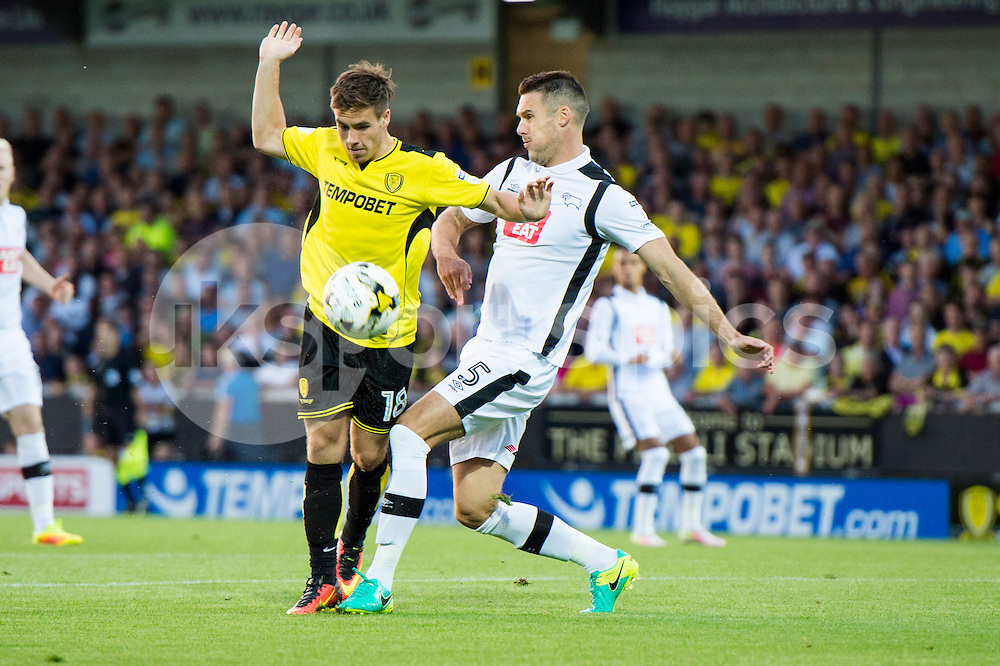 Will Miller of Burton Albion and Jason Shackell of Derby County compete for the ball during the EFL Sky Bet Championship match between Burton Albion and Derby County at the Pirelli Stadium, Burton upon Trent, England on 26 August 2016. Photo by Brandon Griffiths.