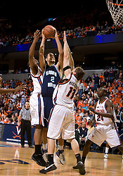 Old Dominion forward Gerald Lee (12) shoots over Virginia forward Laurynas Mikalauskas (11).  The Virginia Cavaliers men's basketball team defeated the Old Dominion Monarchs 80-76 in the second round of the College Basketball Invitational (CBI) at the University of Virginia's John Paul Jones Arena in Charlottesville, VA on March 24, 2008.