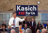 Hempstead, New York, USA. April 4, 2016. JOHN KASICH, Republican presidential candidate and governor of Ohio, points his finger as he speaks in front of a 'Kasich For Us' banner, at the Town Hall he hosts at Hofstra University David Mack Student Center in Long Island. The New York primary is April 19, and Kasich is the first of the three GOP presidential candidates to campaign in Nassau and Suffolk Counties, and is in third place in number of delegates won.