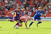 Jack Munns scores the opening goal during the Vanarama National League match between Lincoln City and Cheltenham Town at Sincil Bank, Lincoln, United Kingdom on 8 August 2015. Photo by Antony Thompson.