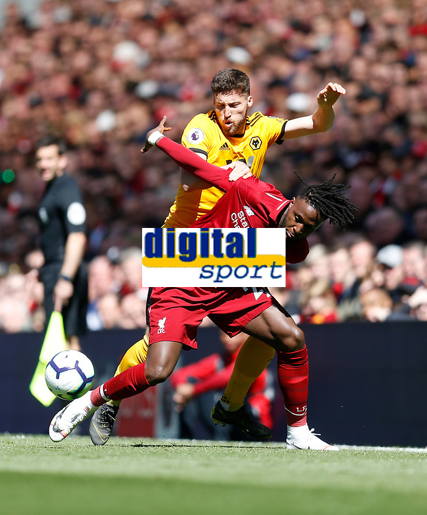 Football - 2018 / 2019 Premier League - Liverpool vs. Wolverhampton Wanderers <br /> <br /> Divock Origi of Liverpool vies with Matt Doherty of Wolverhampton Wanderers, at Anfield<br /> <br /> COLORSPORT/BRUCE WHITE