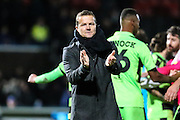 Forest Green Rovers manager, Mark Cooper applauds the fans at the end of the match during the Vanarama National League match between Macclesfield Town and Forest Green Rovers at Moss Rose, Macclesfield, United Kingdom on 12 November 2016. Photo by Shane Healey.
