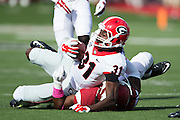 LITTLE ROCK, AR - OCTOBER 18:  Chris Conley #31 of the Georgia Bulldogs is tackled during a game against the Arkansas Razorbacks at War Memorial Stadium on October 18, 2014 in Little Rock, Arkansas.  The Bulldogs defeated the Razorbacks 45-32.  (Photo by Wesley Hitt/Getty Images) *** Local Caption *** Chris Conley
