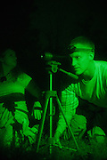 Dr. Bob Staten peers through a night vision scope while hunting for Bigfoot in rural Alabama on October 18, 2013. Staten lives in Florida and is a Bigfoot Field Research Organization investigator, who follows-up on potential sightings and evidence of Sasquatch.