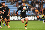 Wasps fullback Juan De Jongh (23) runs with the ball during the Gallagher Premiership Rugby match between Wasps and London Irish at the Ricoh Arena, Coventry, England on 20 October 2019.
