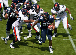 Virginia running back Keith Payne (32) avoids a tackle attempt in the backfield by Virginia defensive end Will Hall (93).  The Virginia Cavaliers football team played the annual spring football scrimmage at Scott Stadium on the Grounds of the University of Virginia in Charlottesville, VA on April 18, 2009.  (Special to the Daily Progress / Jason O. Watson)